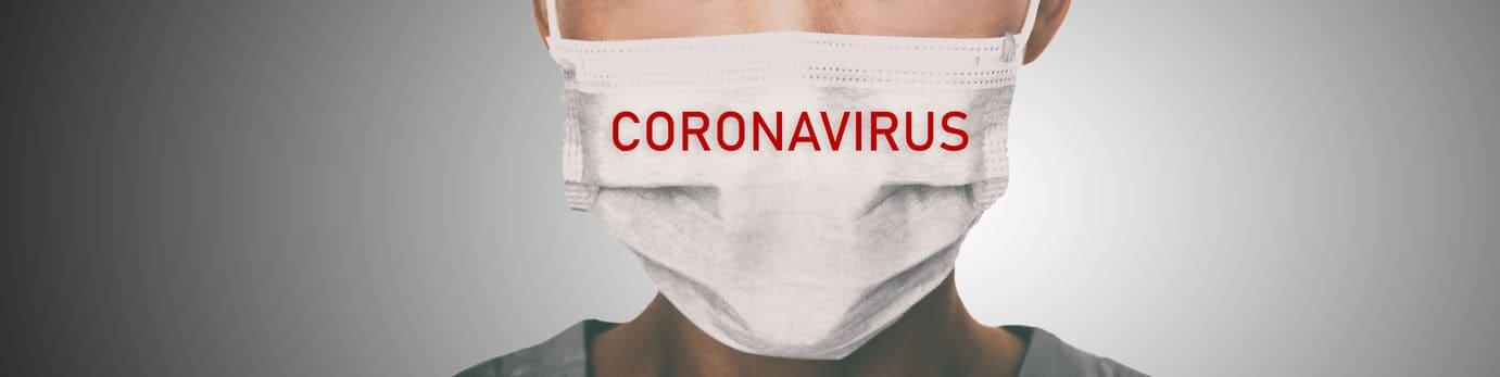 Coronavirus prevention panoramic banner doctor wearing surgical face mask against coronavirus. Panorama of medical staff people.