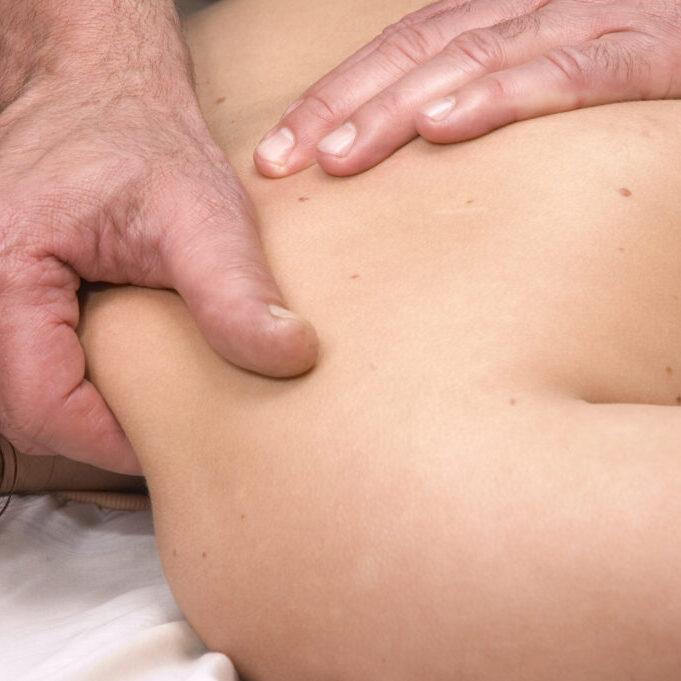 Woman having deep tissue massage